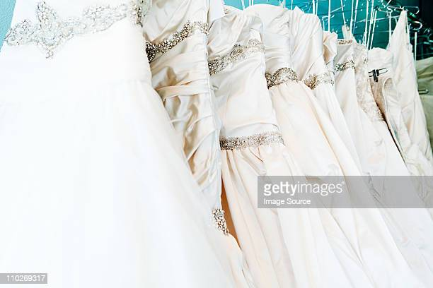 Selection of wedding dresses in boutique