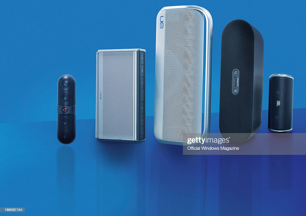 A selection of wireless speakers photographed on a blue background, including (L-R) Beats by Dr Dre Pill, Bose SoundLink II, Logitech UE Boombox, Creative D80 and a JBL Flip, taken on April 9, 2013.