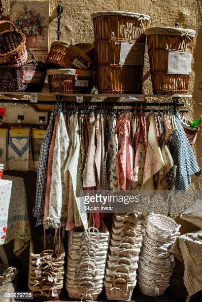 A selection of woven baskets and linen products at a craft homewares shop in Nice France