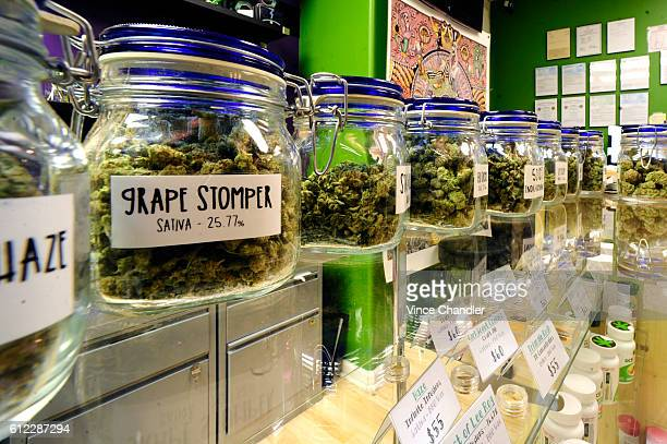 Selections of sativa and indica dominant cannabis strains on display at The Colfax Pot Shop an adultuse marijuana dispensary on Colfax Ave in Denver