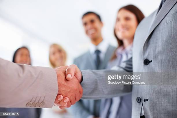 Selective focus businessmen shaking hands