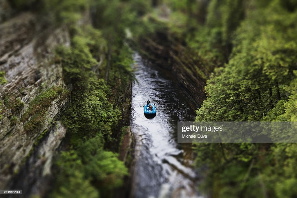 selective focus of a raft floating down a river : Stock Photo