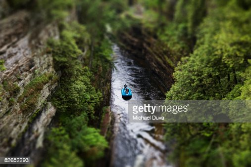 selective focus of a raft floating down a river : Photo
