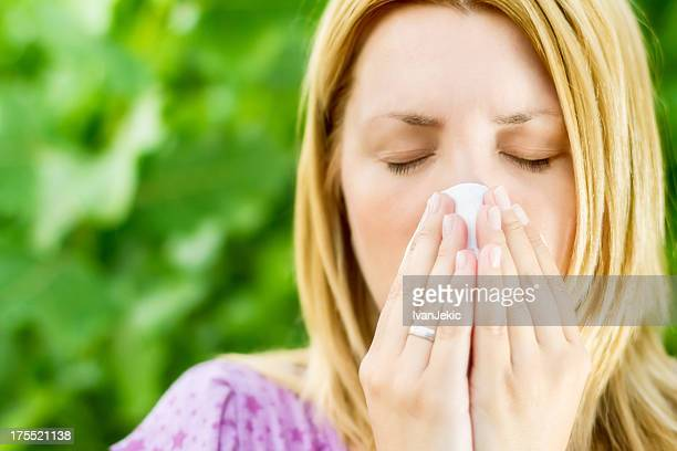 Selective focus of fingers holding the handkerchief sneezing
