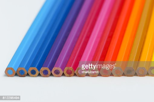Selective focus of pencil colours on near-white chopping board : Stock Photo
