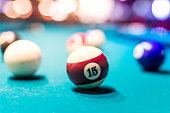 Selective focus on billiard ball number fifteen
