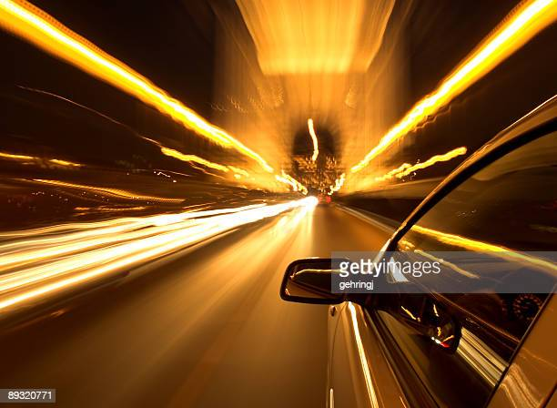 Selective focus photo of car driving at night