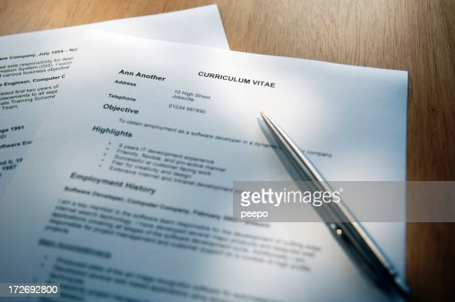 Selective focus shot of a resume and pen