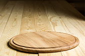 selective focus Wooden pizza plate with wooden background