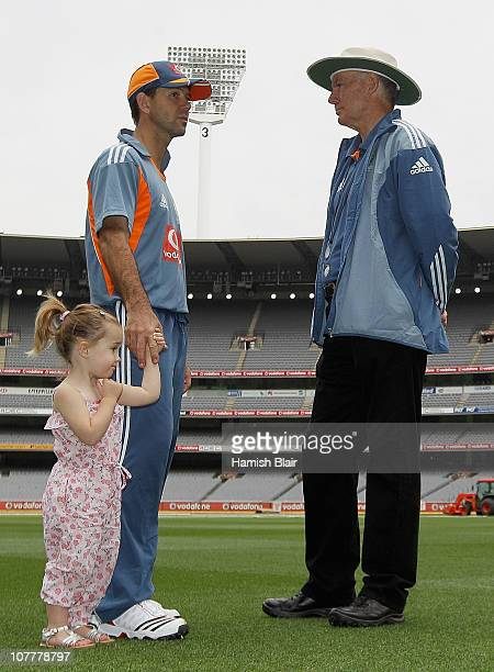 Selector Greg Chappell speaks with Ricky Ponting of Australia as Ponting's daughter Emmy hold his hand during an Australian training session at the...