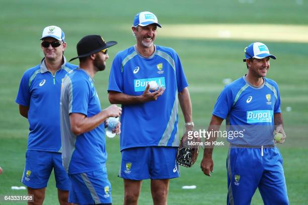 Selector Mark Waugh look on with assistant coaches Jason Gillespie and Ricky Ponting during an Australia T20 training session at Adelaide Oval on...