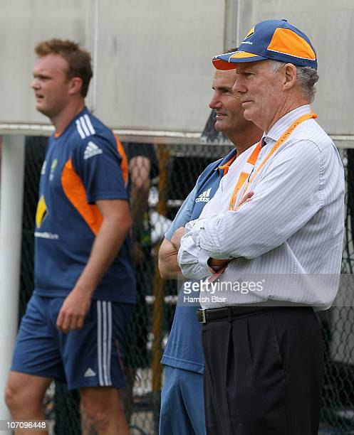 Selectors Andrew Hilditch and Greg Chappell chat as Doug Bollinger prepares to bowl during an Australian nets session at The Gabba on November 24...