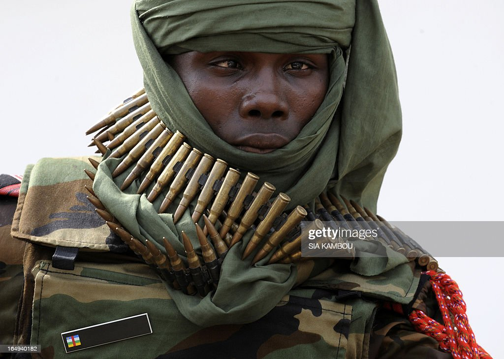 A Seleka rebel carries cartridge belts around his neck in Bangui on March 29, 2013. The African Union has suspended the Central African Republic and ordered sanctions against the rebel leaders who captured the capital Bangui last weekend. AFP PHOTO / SIA KAMBOU
