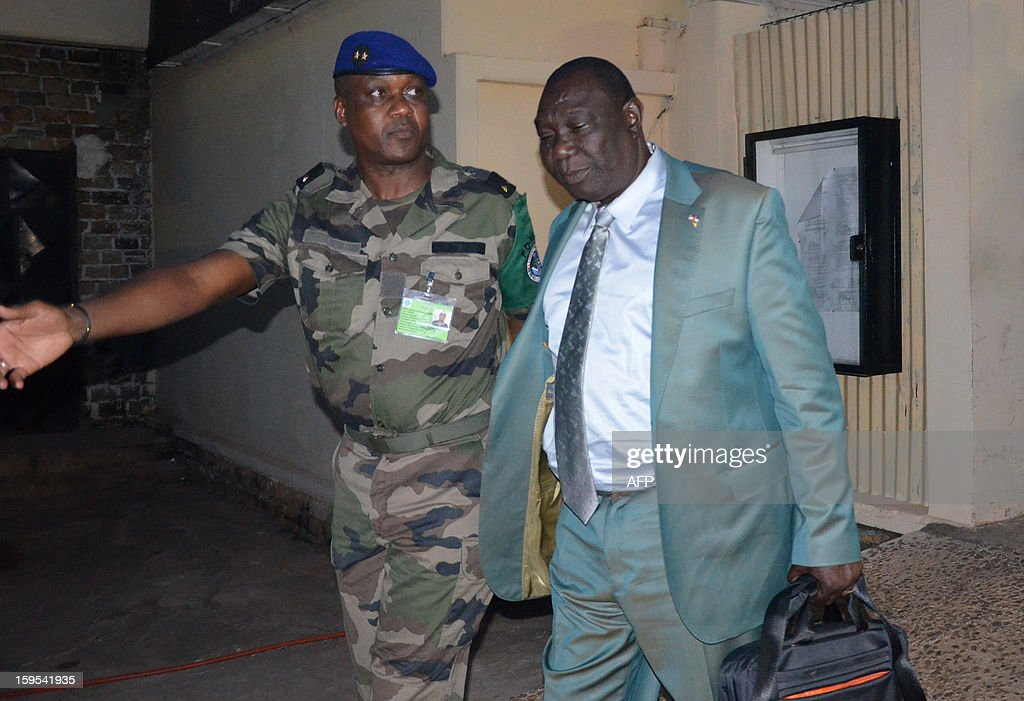 Seleka rebel coalition chief Michel Djotodia (R) is welcomed by leader of the FOMAC (Central Africa Multinational Force) Jean Felix Akaga in Bangui on January 15, 2013. The Seleka rebel alliance in the Central African Republic said it backed opposition figure Nicolas Tiangaye to become prime minister in a move that advances a peace deal reached last week. 'We have just confirmed Mr Tiangaye as prime minister. He is the future prime minister, there is no more objection,' Djotodia told AFP in Brazzaville after talks with the Republic of Congo's President Denis Sassou Nguesso, who heads a follow-up committee monitoring the accord. AFP PHOTO / PATRICK FORT