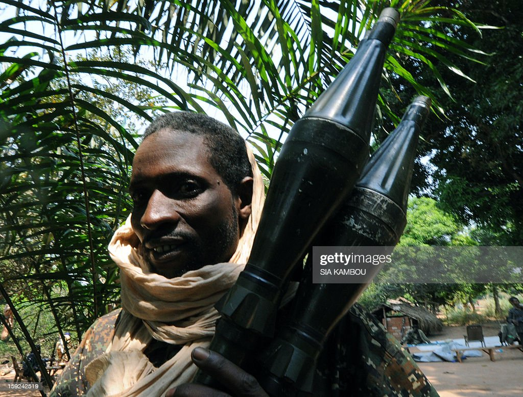 A Seleka rebel coalition member, which launched a major offensive last month, holds on January 10, 2013 a position in a village 12 kilometers from Damara, where troops of the regional African force FOMAC are stationned. Three-way peace talks between the Central African government, the rebel coalition that conquered much of the country over the past month and the political opposition began on January 9 in Gabon. With a lightning advance starting December 10, the rebels took over most of the Central African Republic. They are demanding that Central African President Francois Bozize step down, but the head of state, who took power in a 2003 coup, warned on the eve of the talks that he would not leave his job.