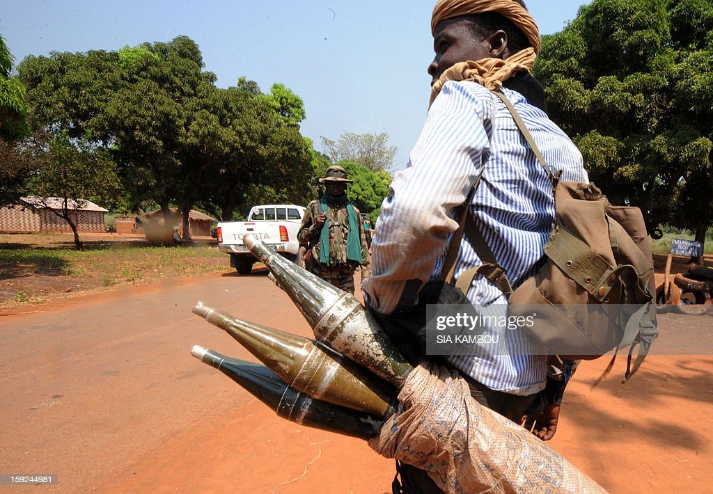 A Seleka rebel coalition member, which launched a major offensive last month, hold a bag of rockets on January 10, 2013 in a village 12 kilometers from Damara, where troops of the regional African force FOMAC are stationned. Three-way peace talks between the Central African government, the rebel coalition that conquered much of the country over the past month and the political opposition began on January 9 in Gabon. With a lightning advance starting December 10, the rebels took over most of the Central African Republic. They are demanding that Central African President Francois Bozize step down, but the head of state, who took power in a 2003 coup, warned on the eve of the talks that he would not leave his job.