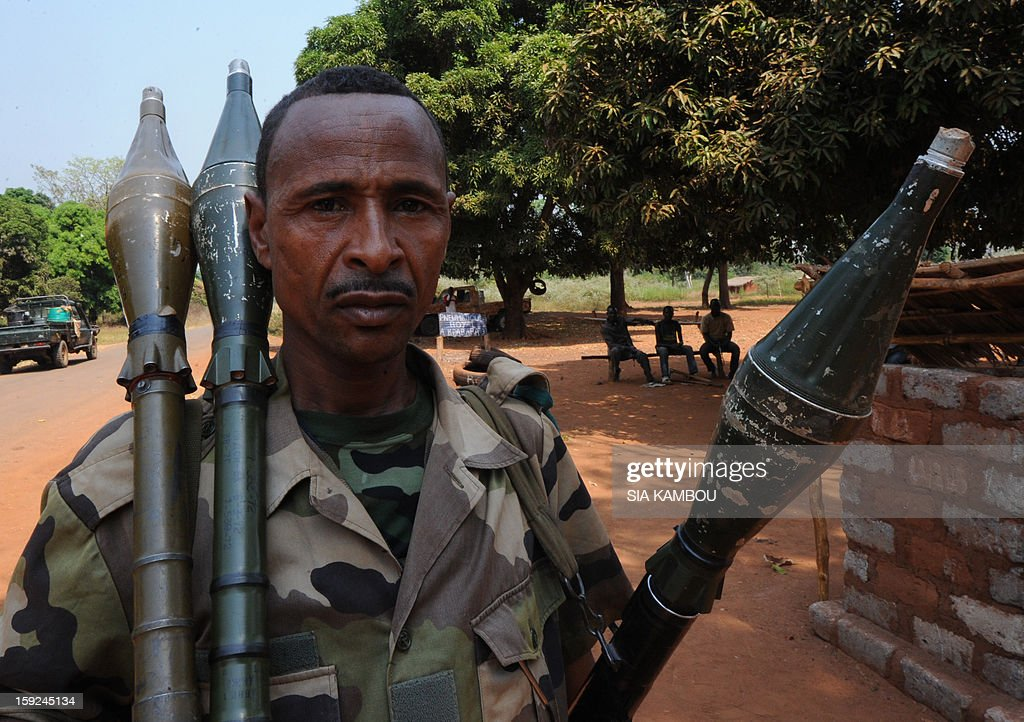 A Seleka rebel coalition member, which launched a major offensive last month, holds on January 10, 2013 rockets in a village 12 kilometers from Damara, where troops of the regional African force FOMAC are stationned. Three-way peace talks between the Central African government, the rebel coalition that conquered much of the country over the past month and the political opposition began on January 9 in Gabon. With a lightning advance starting December 10, the rebels took over most of the Central African Republic. They are demanding that Central African President Francois Bozize step down, but the head of state, who took power in a 2003 coup, warned on the eve of the talks that he would not leave his job. AFP PHOTO/ SIA KAMBOU