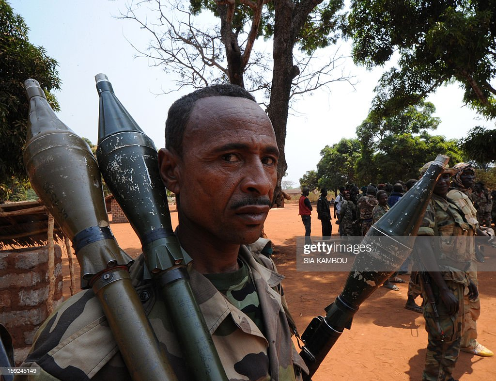 A Seleka rebel coalition member, which launched a major offensive last month, holds rockets on January 10, 2013 in a village 12 kilometers from Damara, where troops of the regional African force FOMAC are stationned. Three-way peace talks between the Central African government, the rebel coalition that conquered much of the country over the past month and the political opposition began on January 9 in Gabon. With a lightning advance starting December 10, the rebels took over most of the Central African Republic. They are demanding that Central African President Francois Bozize step down, but the head of state, who took power in a 2003 coup, warned on the eve of the talks that he would not leave his job. AFP PHOTO/ SIA KAMBOU
