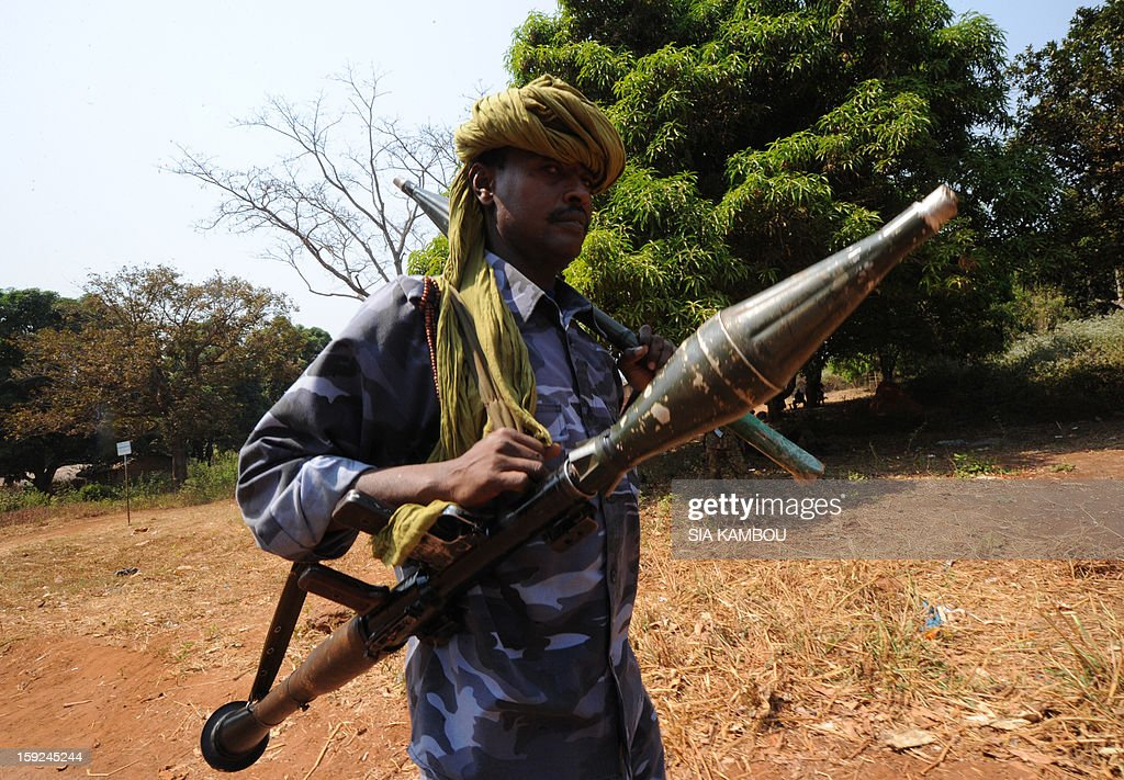 A Seleka rebel coalition member, which launched a major offensive last month, holds a rocket on January 10, 2013 in a village 12 kilometers from Damara, where troops of the regional African force FOMAC are stationned. Three-way peace talks between the Central African government, the rebel coalition that conquered much of the country over the past month and the political opposition began on January 9 in Gabon. With a lightning advance starting December 10, the rebels took over most of the Central African Republic. They are demanding that Central African President Francois Bozize step down, but the head of state, who took power in a 2003 coup, warned on the eve of the talks that he would not leave his job. AFP PHOTO/ SIA KAMBOU