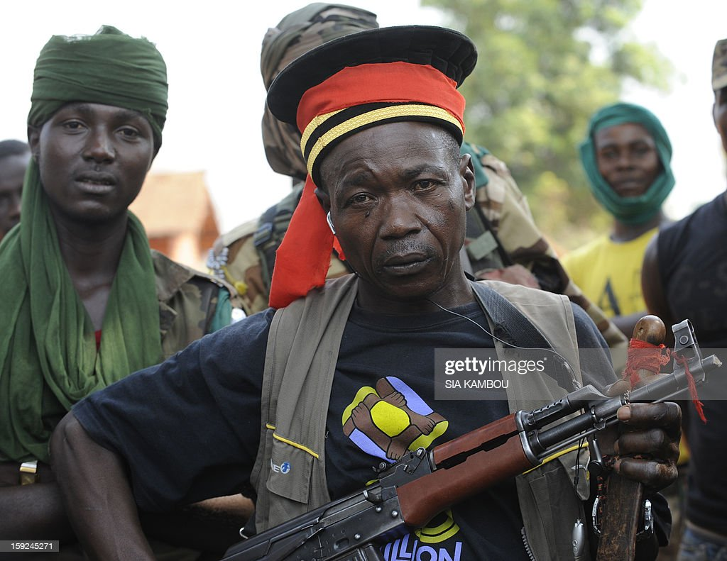 A Seleka rebel coalition member, which launched a major offensive last month, wears on January 10, 2013 the hat of a prosecutor, who allegedly fled rebel adavances, in a village 12 kilometers from Damara, where troops of the regional African force FOMAC are stationned. Three-way peace talks between the Central African government, the rebel coalition that conquered much of the country over the past month and the political opposition began on January 9 in Gabon. With a lightning advance starting December 10, the rebels took over most of the Central African Republic. They are demanding that Central African President Francois Bozize step down, but the head of state, who took power in a 2003 coup, warned on the eve of the talks that he would not leave his job. AFP PHOTO/ SIA KAMBOU