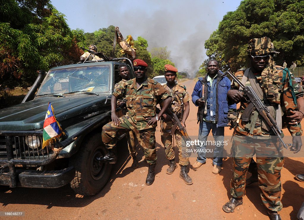 Seleka rebel coalition member, which launched a major offensive last month, hold on January 10, 2013 a position in a village 12 kms from Damara, where troops of the regional African force FOMAC are stationned. Three-way peace talks between the Central African government, the rebel coalition that conquered much of the country over the past month and the political opposition began on January 9 in Gabon. With a lightning advance starting December 10, the rebels took over most of the Central African Republic. They are demanding that Central African President Francois Bozize step down, but the head of state, who took power in a 2003 coup, warned on the eve of the talks that he would not leave his job.