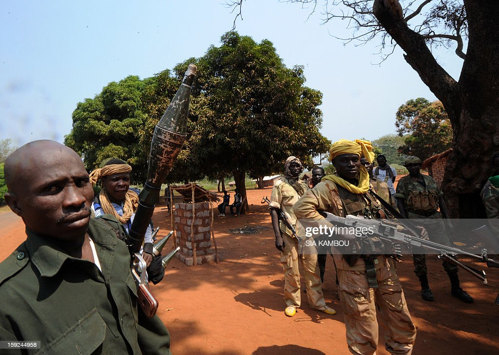 Seleka rebel coalition members, which launched a major offensive last month, hold on January 10, 2013 a position in a village 12 kilometers from Damara, where troops of the regional African force FOMAC are stationned. Three-way peace talks between the Central African government, the rebel coalition that conquered much of the country over the past month and the political opposition began on January 9 in Gabon. With a lightning advance starting December 10, the rebels took over most of the Central African Republic. They are demanding that Central African President Francois Bozize step down, but the head of state, who took power in a 2003 coup, warned on the eve of the talks that he would not leave his job. AFP PHOTO/ SIA KAMBOU