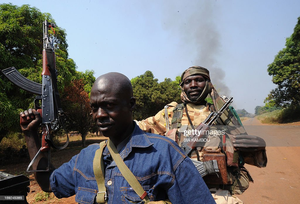 Seleka rebel coalition members, which launched a major offensive last month, hold on January 10, 2013 a position in a village 12 kms from Damara, where troops of the regional African force FOMAC are stationned. Three-way peace talks between the Central African government, the rebel coalition that conquered much of the country over the past month and the political opposition began on January 9 in Gabon. With a lightning advance starting December 10, the rebels took over most of the Central African Republic. They are demanding that Central African President Francois Bozize step down, but the head of state, who took power in a 2003 coup, warned on the eve of the talks that he would not leave his job. AFP PHOTO/ SIA KAMBOU