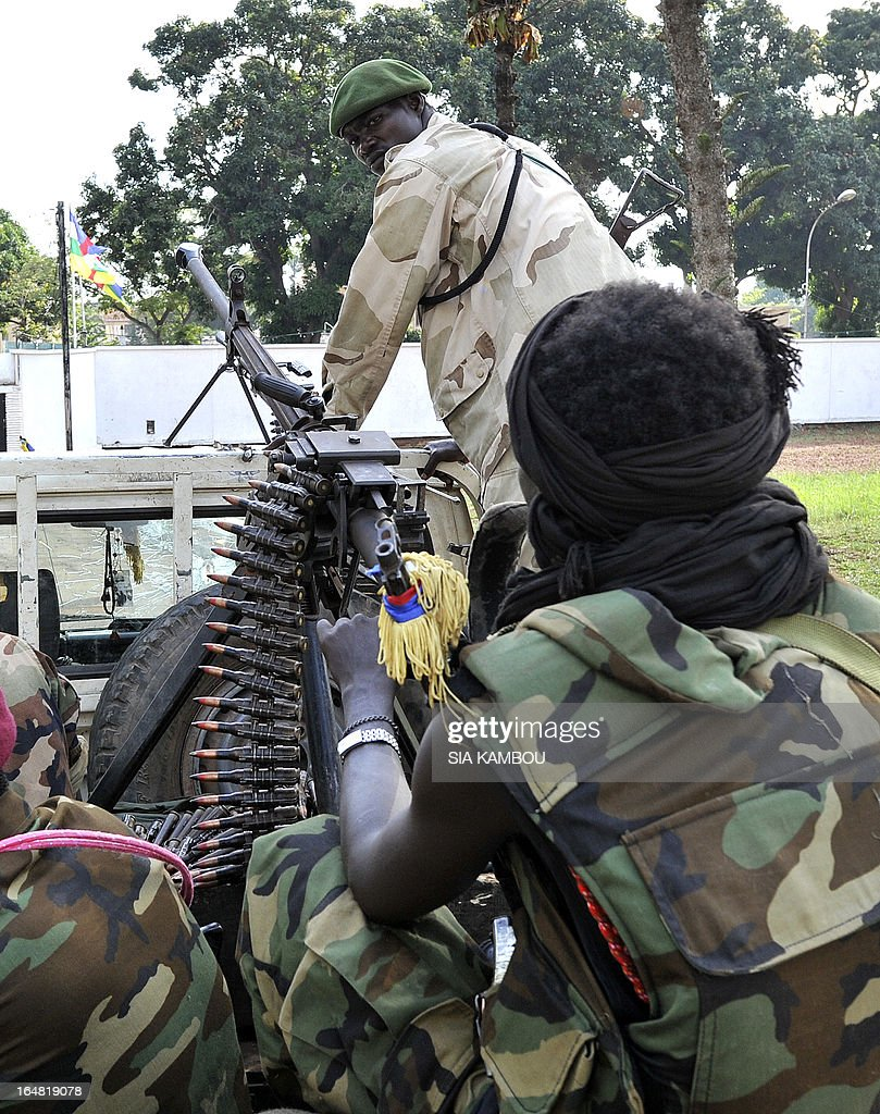 Seleka rebels are sitting on a pick up truck mounted with a machine gun outside the pillaged presidential palace of deposed president in Bangui on March 28, 2013. Ousted Central African Republic president Francois Bozize, who fled after rebels took the capital Bangui, has taken refuge in Cameroon.