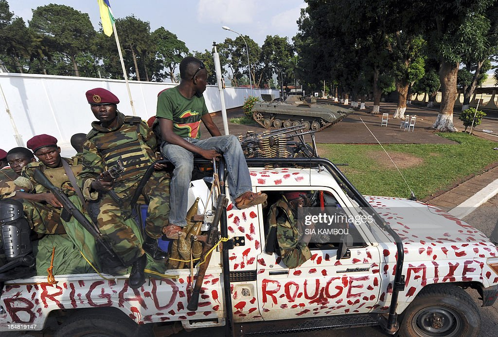 Seleka rebels of the 'Red Squad' patrol on a pick up truck near the pillaged presidential palace of deposed president in Bangui on March 28, 2013. Ousted Central African Republic president Francois Bozize, who fled after rebels took the capital Bangui, has taken refuge in Cameroon.