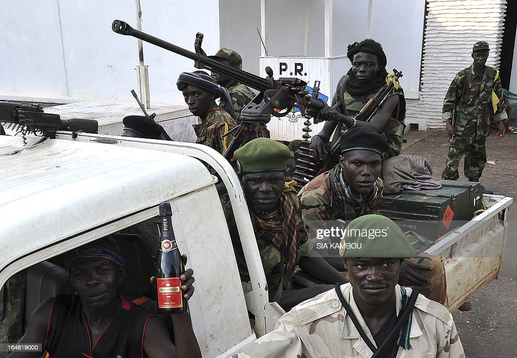Seleka rebels on a pick up truck mounted with a machine gun leave the pillaged presidential palace of deposed president in Bangui on March 28, 2013. Ousted Central African Republic president Francois Bozize, who fled after rebels took the capital Bangui, has taken refuge in Cameroon.