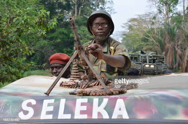 Seleka rebels who seized Bangui in a rapidfire assault a week ago patrol in an armoured vehicle in the south of Bangui on April 1 2013 The Central...