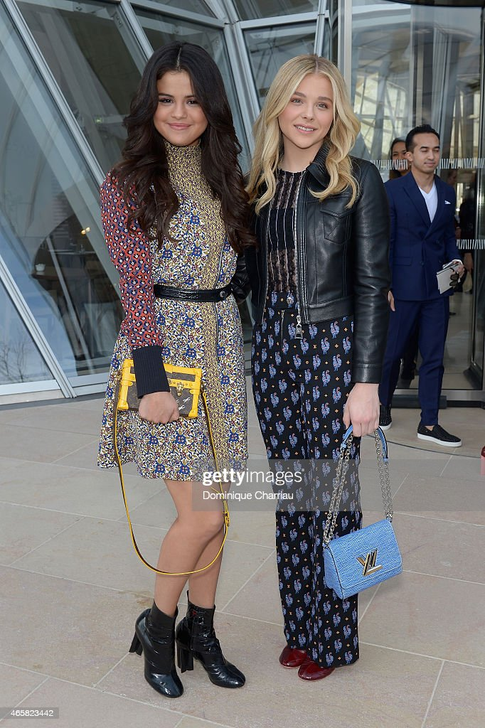 Selena Gomez and Chloe Grace Moretz attend the Louis Vuitton show as part of the Paris Fashion Week Womenswear Fall/Winter 2015/2016 on March 11, 2015 in Paris, France.