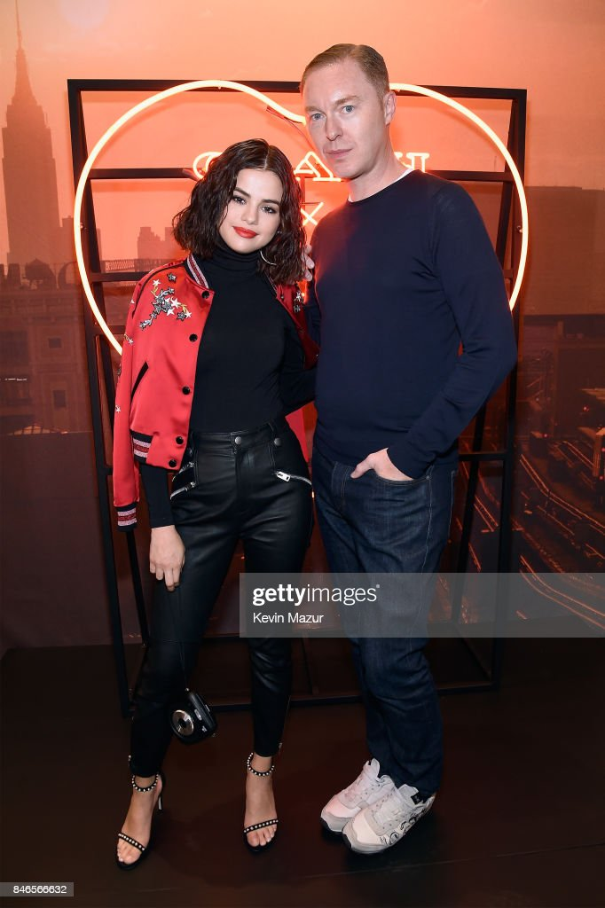 Selena Gomez (L) and Creative Director of Coach Stuart Vevers pose during the Coach In-Store Event with Selena Gomez at Coach Boutique on September 13, 2017 in New York City.
