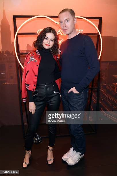 Selena Gomez and Creative Director of Coach Stuart Vevers pose during the Coach InStore Event with Selena Gomez at Coach Boutique on September 13...