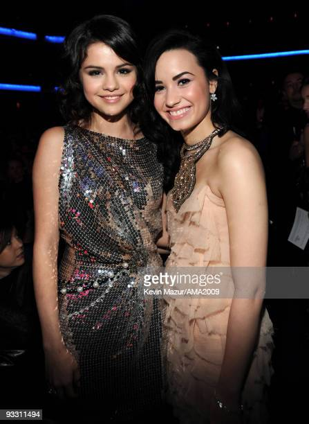 Selena Gomez and Demi Lavato at the 2009 American Music Awards at Nokia Theatre LA Live on November 22 2009 in Los Angeles California