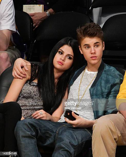 Selena Gomez and Justin Bieber attend a basketball game between the San Antonio Spurs and the Los Angeles Lakers at Staples Center on April 17 2012...
