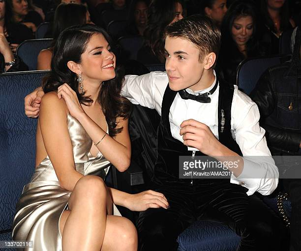 Selena Gomez and Justin Bieber in the audience at the 2011 American Music Awards at the Nokia Theatre LA LIVE on November 20 2011 in Los Angeles...