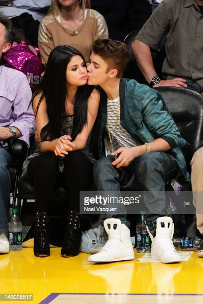 Selena Gomez and Justin Bieber kiss at a basketball game between the San Antonio Spurs and the Los Angeles Lakers at Staples Center on April 17 2012...