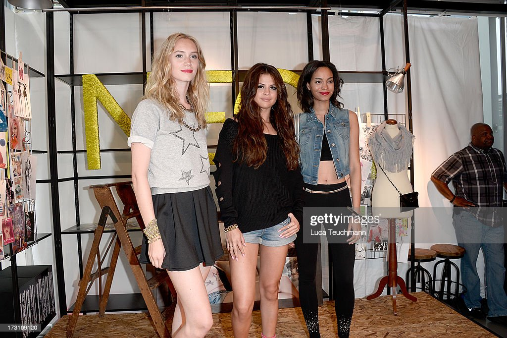 Selena Gomez (C) and models attend a photocall to launch the Selena Gomez by adidas NEO collection on July 9, 2013 in Berlin, Germany.