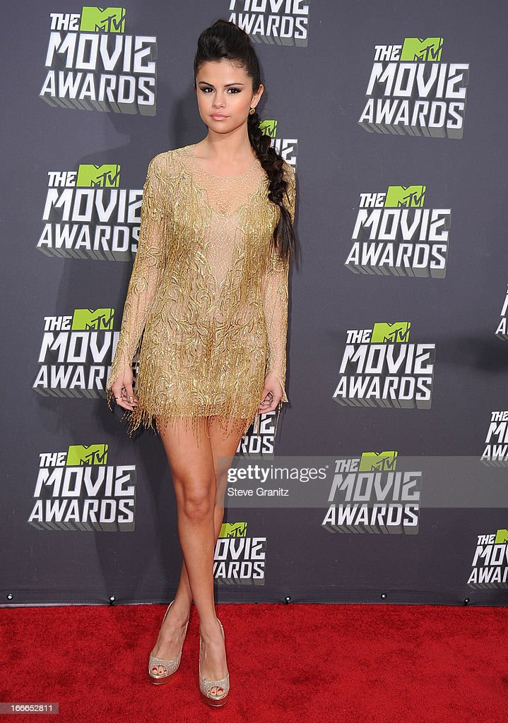 <a gi-track='captionPersonalityLinkClicked' href=/galleries/search?phrase=Selena+Gomez&family=editorial&specificpeople=4295969 ng-click='$event.stopPropagation()'>Selena Gomez</a> arrives at the 2013 MTV Movie Awards at Sony Pictures Studios on April 14, 2013 in Culver City, California.