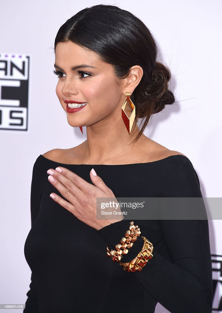 Selena Gomez arrives at the 2014 American Music Awards Arrivals at Nokia Theatre LA Live on November 23 2014 in Los Angeles California