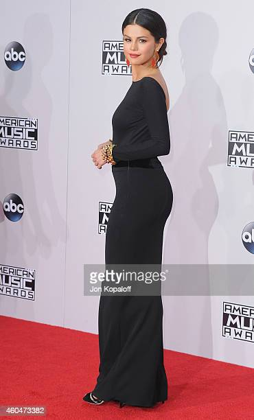 Selena Gomez arrives at the 2014 American Music Awards at Nokia Theatre LA Live on November 23 2014 in Los Angeles California