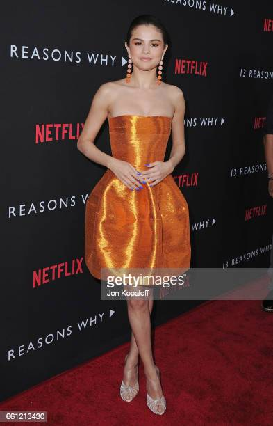 Selena Gomez arrives at the Los Angeles Premiere of Netflix's '13 Reasons Why' at Paramount Pictures on March 30 2017 in Los Angeles California