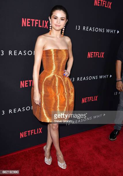 Selena Gomez arrives at the Premiere Of Netflix's '13 Reasons Why' at Paramount Pictures on March 30 2017 in Los Angeles California