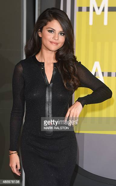 Selena Gomez arrives on the red carpet at the MTV Video Music Awards August 30 2015 at the Microsoft Theater in Los Angeles California AFP PHOTO/Mark...