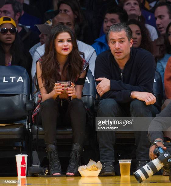 Selena Gomez attends a basketball game between the Sacramento Kings and the Los Angeles Lakers at Staples Center on March 17 2013 in Los Angeles...