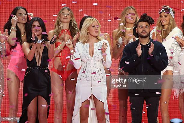 Selena Gomez Ellie Goulding and The Weeknd dance with Victoria's Secret Angels during the 2015 Victoria's Secret Fashion Show at Lexington Avenue...