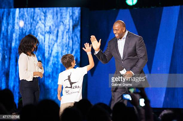 Selena Gomez Ezra Frech and Magic Johnson speak on stage during We Day at Allstate Arena on April 30 2015 in Rosemont Illinois