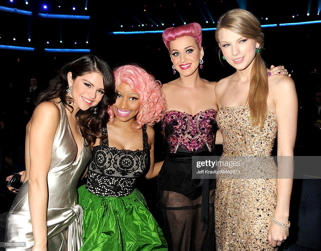<a gi-track='captionPersonalityLinkClicked' href=/galleries/search?phrase=Selena+Gomez&family=editorial&specificpeople=4295969 ng-click='$event.stopPropagation()'>Selena Gomez</a>, <a gi-track='captionPersonalityLinkClicked' href=/galleries/search?phrase=Nicki+Minaj+-+Performer&family=editorial&specificpeople=6362705 ng-click='$event.stopPropagation()'>Nicki Minaj</a>, <a gi-track='captionPersonalityLinkClicked' href=/galleries/search?phrase=Katy+Perry&family=editorial&specificpeople=599558 ng-click='$event.stopPropagation()'>Katy Perry</a> and <a gi-track='captionPersonalityLinkClicked' href=/galleries/search?phrase=Taylor+Swift&family=editorial&specificpeople=619504 ng-click='$event.stopPropagation()'>Taylor Swift</a> in the audience at the 2011 American Music Awards at the Nokia Theatre L.A. LIVE on November 20, 2011 in Los Angeles, California.