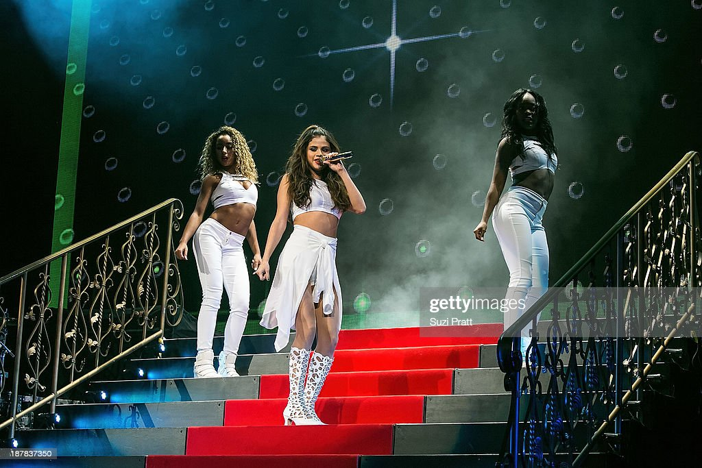 Selena Gomez performs live at Key Arena on November 12, 2013 in Seattle, Washington.